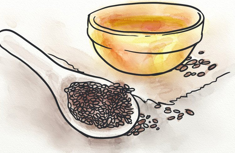 A spoon of flaxseed and a bowl of oil