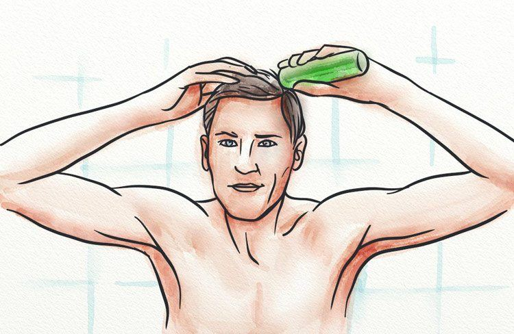 A man applying a tonic to his scalp