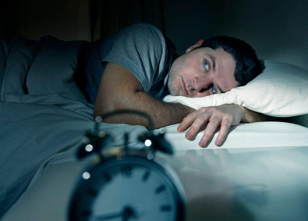 A man lying awake at night