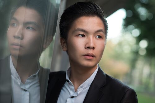 A young man with a healthy, Asian hairline